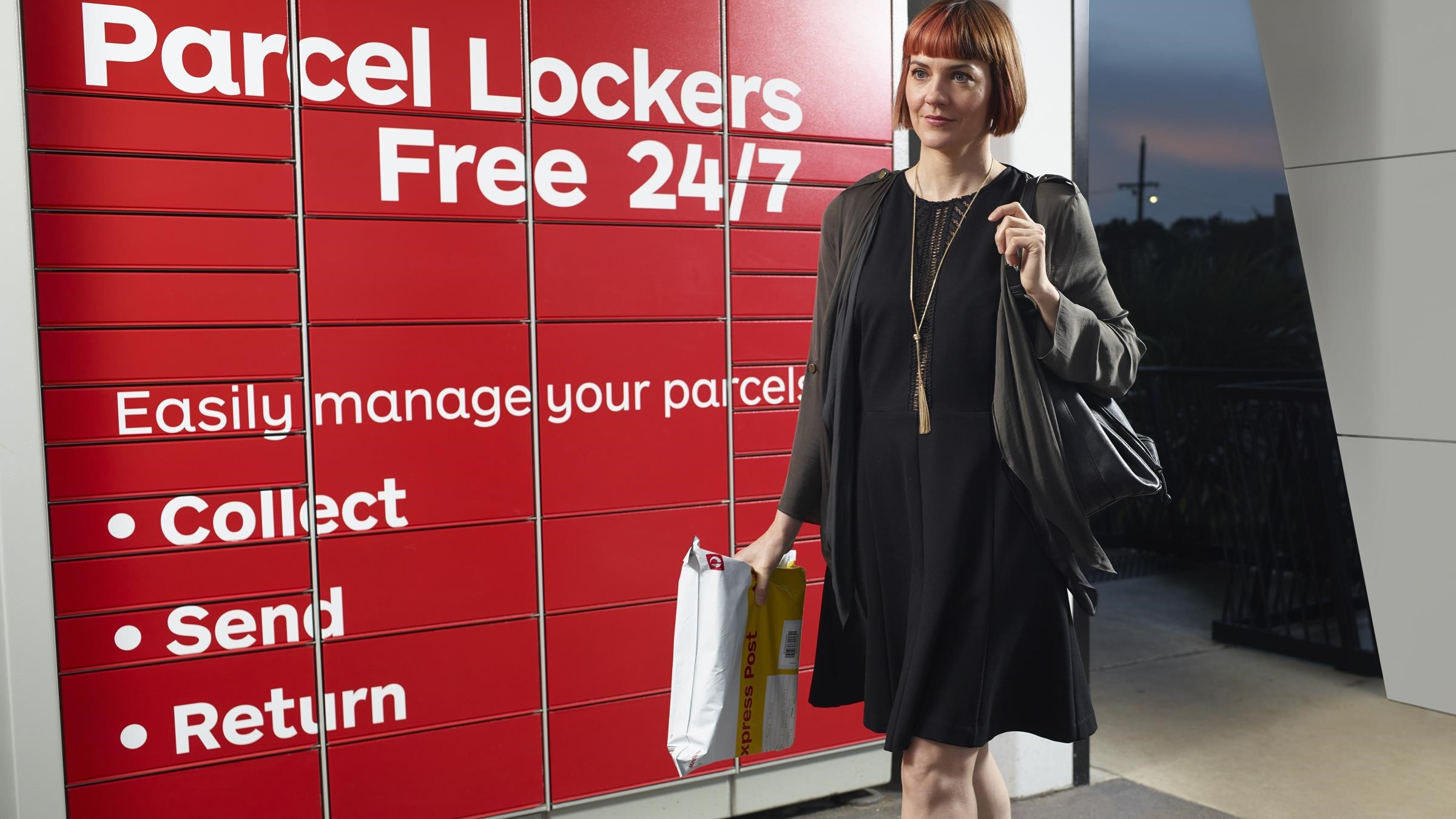 woman collecting parcel from post office